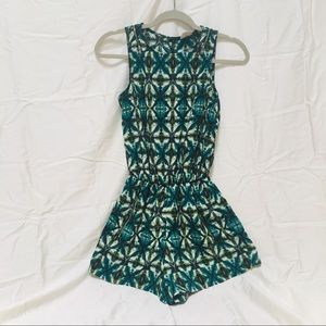 Small green tribal print romper